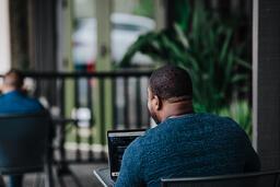 Man Facing Away Working on Laptop  image 7