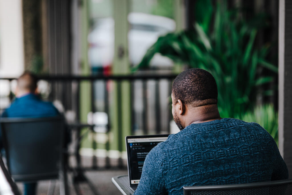 Man Facing Away Working on Laptop large preview