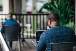 Man Facing Away Working on Laptop  image 8