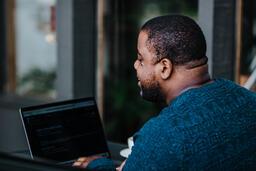 Man Working on Laptop at Coffee Shop  image 5