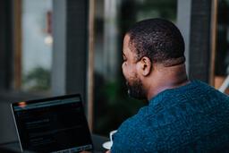 Man Working on Laptop at Coffee Shop  image 4