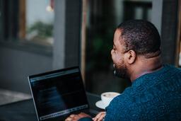 Man Working on Laptop at Coffee Shop  image 3