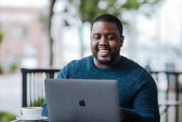 Man Working on Laptop at Coffee Shop  image 2