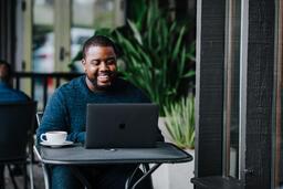 Man Working on Laptop at Coffee Shop  image 10