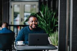 Man Working on Laptop at Coffee Shop  image 8