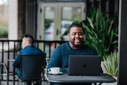 Man Working on Laptop at Coffee Shop  image 6