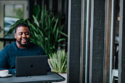 Man Working on Laptop at Coffee Shop  image 7