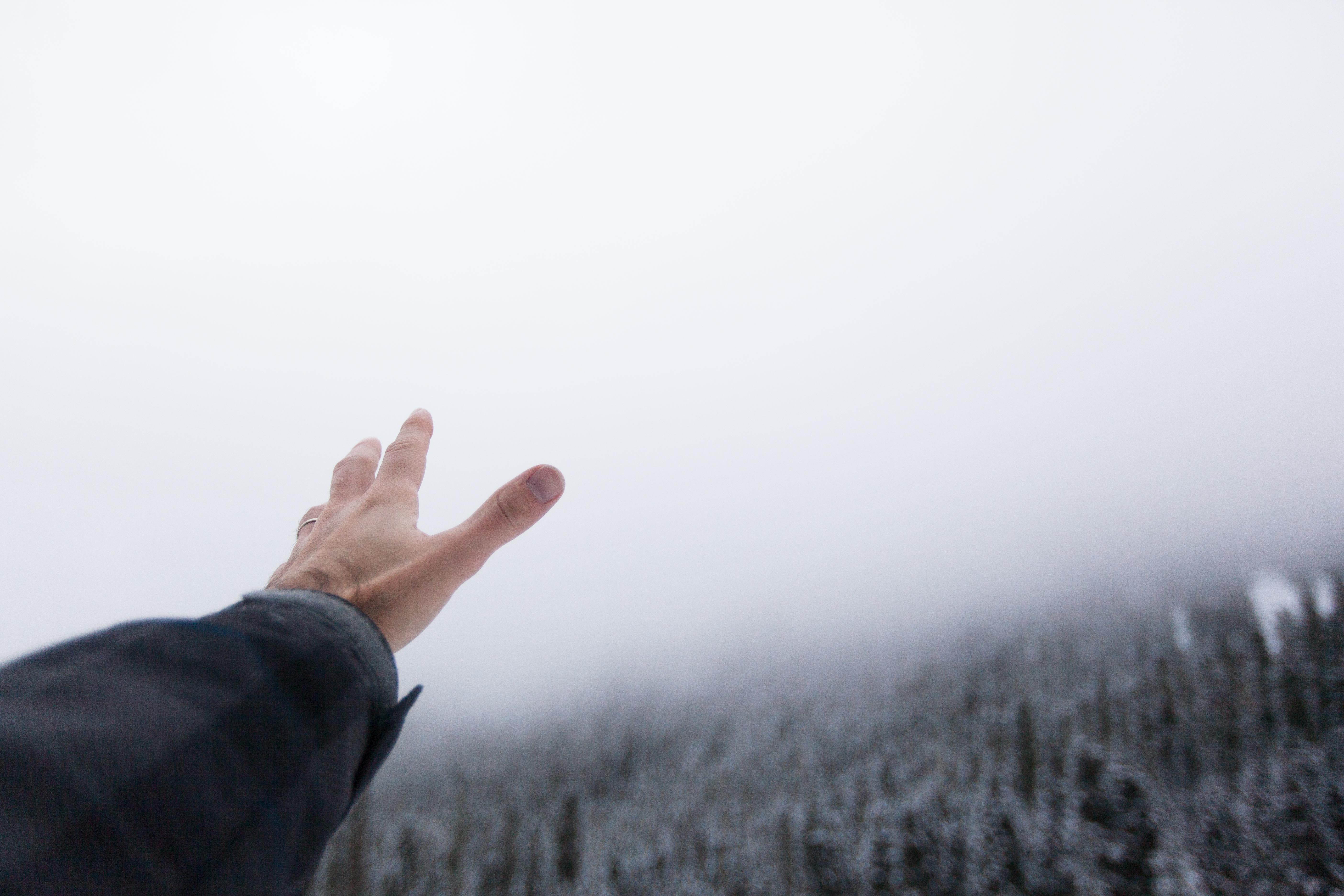 Winter Wonderland man reaching for fog